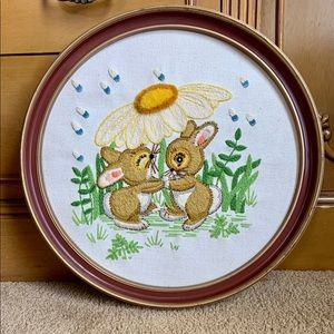 Vintage 1970s rabbits under a flower needlepoint